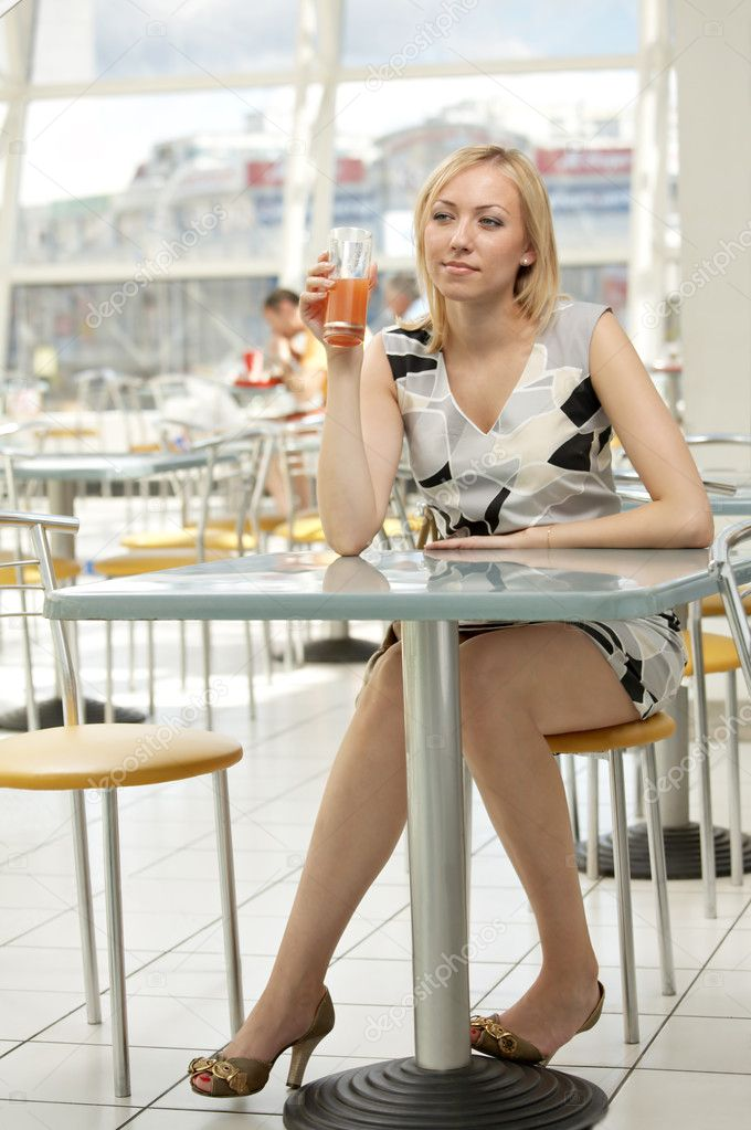 The girl in cafe drinks juice  Stock Photo #1903465