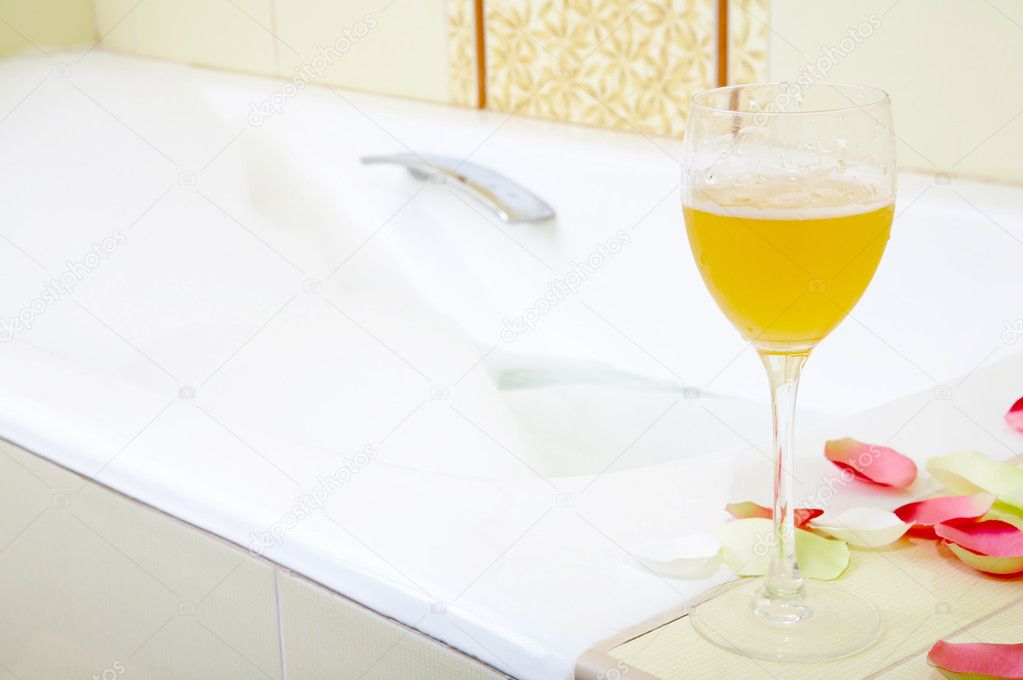 Still-life a glass with a drink against a bath with foam  Stock Photo #1904536