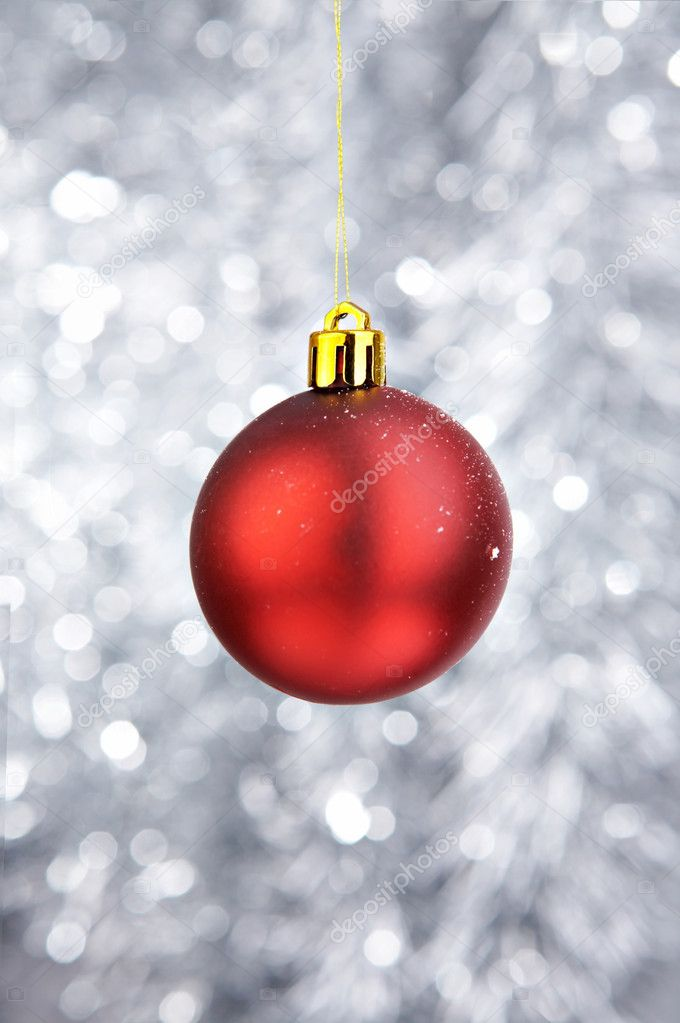 Red Christmas-tree decoration on a silvery background — Stock Photo #1904582