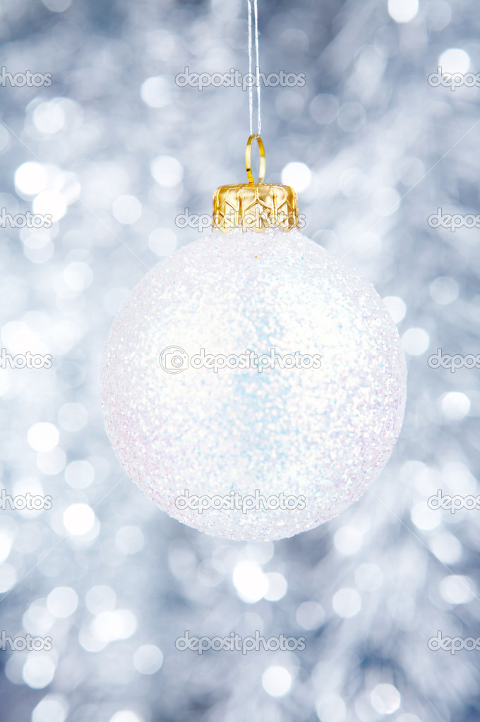 White Christmas-tree decoration on a silvery background — Stock Photo #1904688