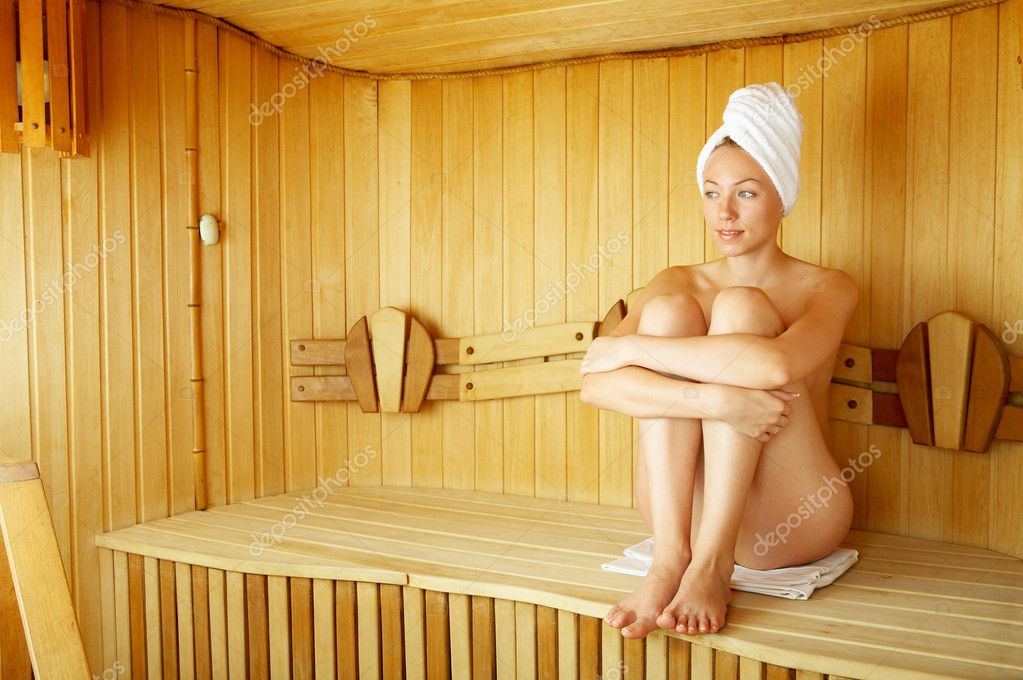 The naked girl sits on a bench in a sauna — Stock Photo #1904826