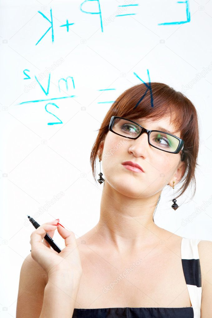 The girl in glasses thoughtfully looks at formulas — Stock Photo #2279510