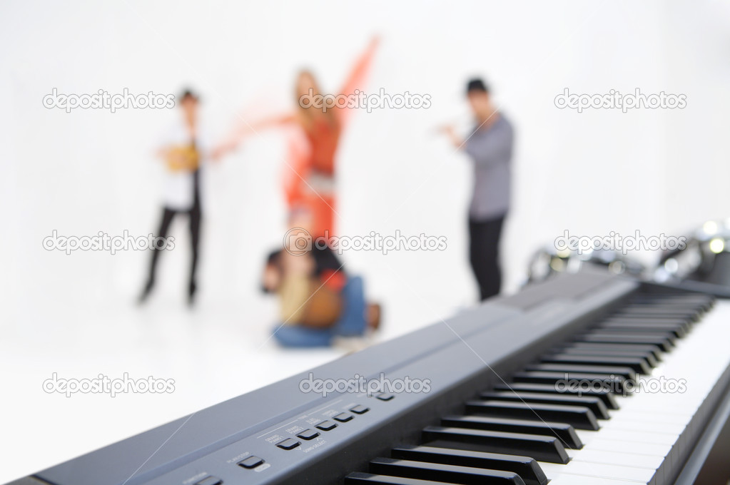 Synthesizer close up, on degradation musicians and the dancer  Stock Photo #2279552