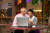 Young couple in café — Stock Photo