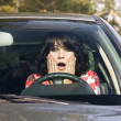 Scared woman in a car -  