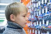Boy in shop — Stock Photo