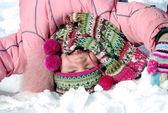 Happy little girl in winter clothing — Stock Photo