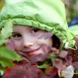 Stock Photo: Smiling little girl in the hood