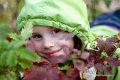 Smiling little girl in the hood — Stock Photo