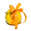 Yellow apple with a gift bow — Stock Photo #1664636