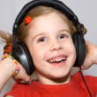 Little girl with headphones — Stock Photo