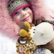Smiling little girl in winter clothing — Stok fotoğraf