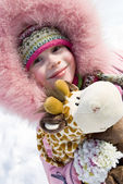 Smiling little girl in winter clothing — Stock Photo
