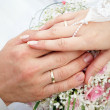 Hands of groom and bride - Stock Photo