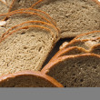 Stock Photo: Cutting bread macro