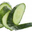 Stock Photo: Cut cucumber in water