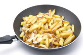 Fried cutting potatoes in griddle — Stock Photo