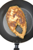 Fried fish steak on griddle closeup — Stock Photo