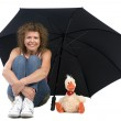 Woman with umbrella and toy — Stock Photo #1699015