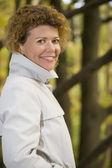 Portrait happy woman in park close up — Stock Photo