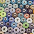 图库照片: Spool of thread background