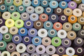 Spool of thread background — Stockfoto