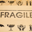 Stock Photo: Fragile sign on wood