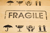 Fragile sign on wood — Stock Photo