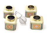 Tea boxes with strainer — Stock Photo