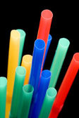 Drinking straws on black close up — Stock Photo