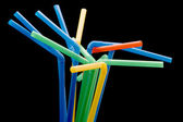 Drinking straws on black — Stock Photo