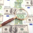 Magnifier glass with money — Stock Photo