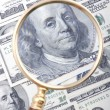 Magnifier with dollar closeup — Stock Photo