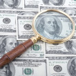 Royalty-Free Stock Photo: Magnifier with dollar
