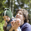 Mother and child in park closeup — Stock Photo
