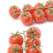 Raw tomato closeup on white — Stock Photo