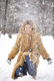Woman in the winter park — Stock Photo