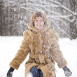 Woman with snow in park — Stock Photo