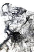 Black smoke on white background — 图库照片