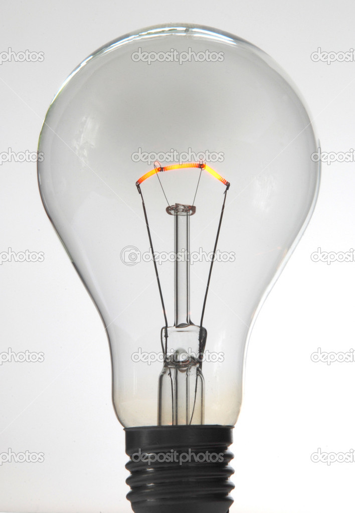 Shimmering electric light bulb against white background — Stock Photo #1604269
