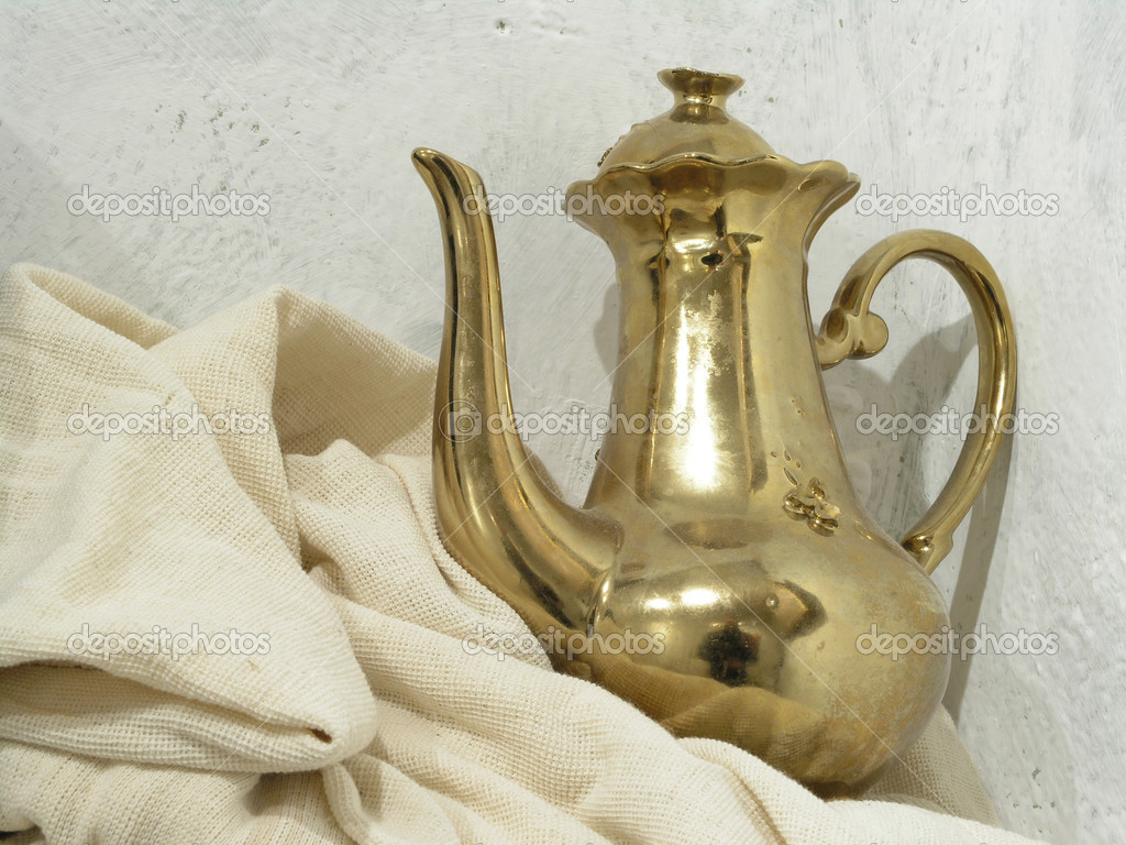Golden cofee pot placed on the linen drapery     Stock Photo #1604674