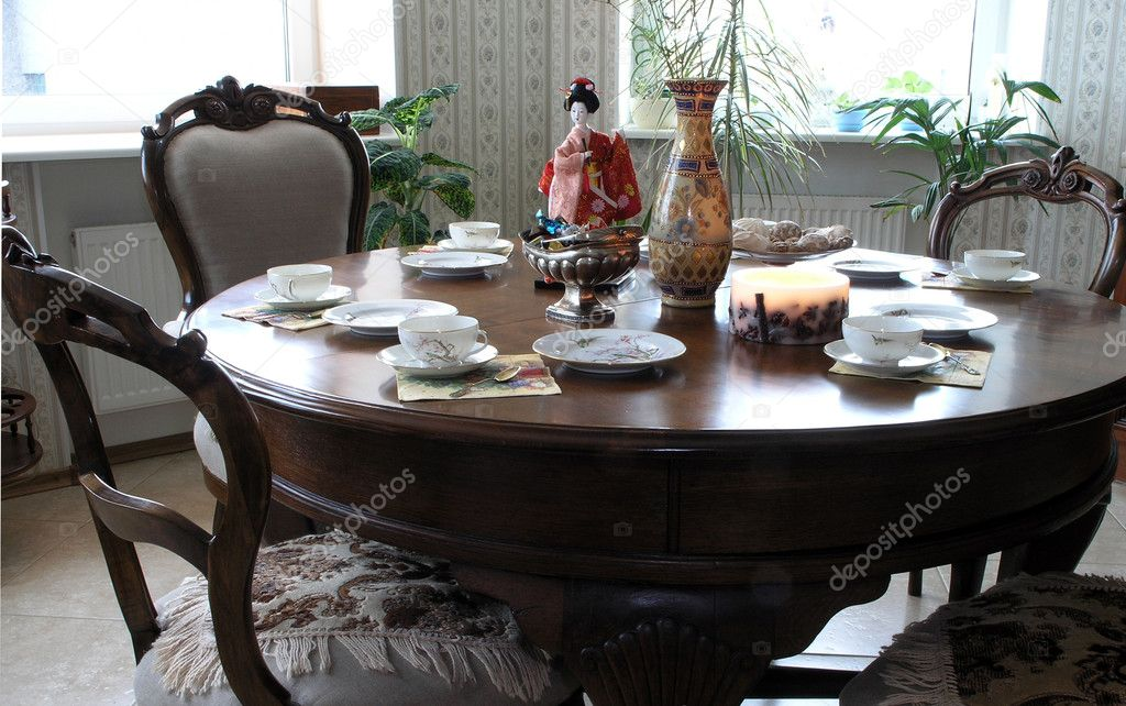 A table set for tea-drinking with a chinese vase and a japanese doll         — Stock Photo #1693105