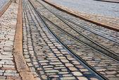 Rails and pavement — Stock Photo