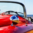 Old classic red jaguar at beach - Stock Photo