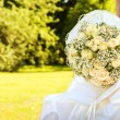 Bride with bridal bouquet - Stock Photo