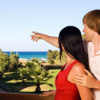 Stock Photo: Young couple on hotels terrace