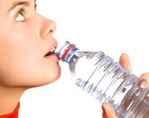 Young beautiful girl with mineral water — Stock Photo