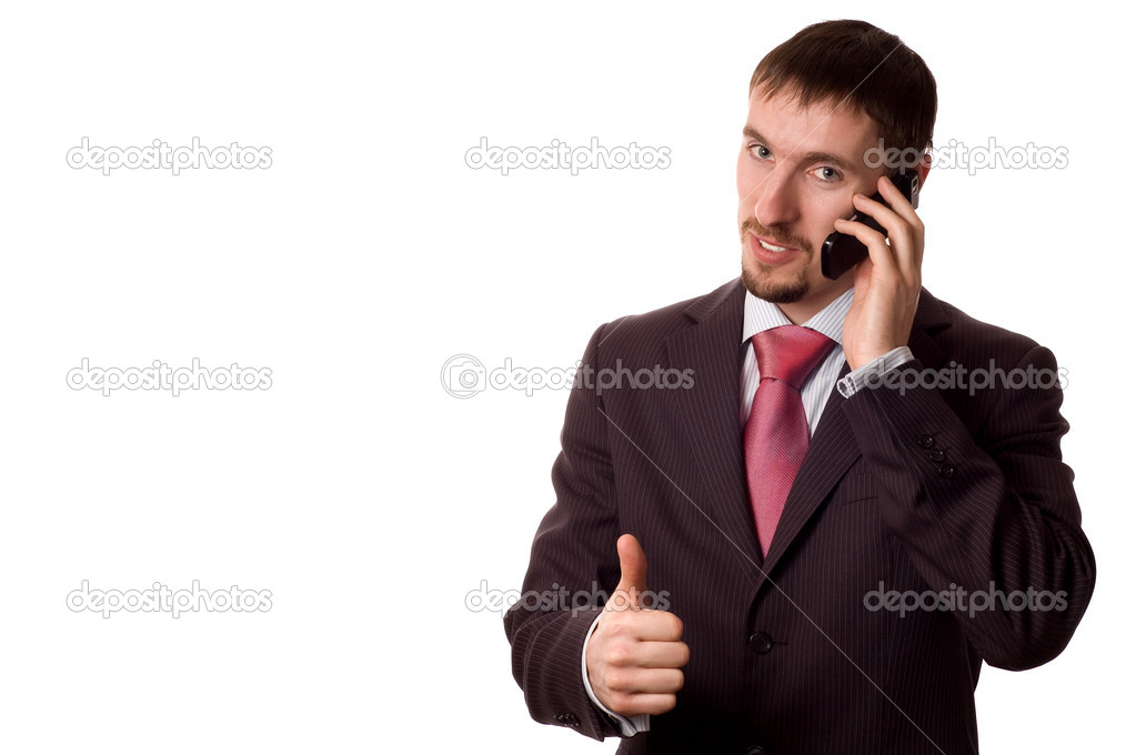 Young modern business man talking on cell phone, with thumbs up (isolated on white) — Stock Photo #1669414