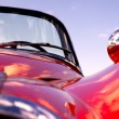 Royalty-Free Stock Photo: Old classic red jaguar at beach