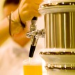 Stock Photo: Bartender pouring beer (shallow dof)